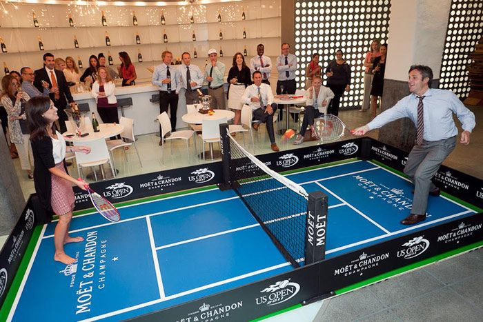 Olympic-themed party ideas - For the 2011 U.S. Open, sponsor Moët & Chandon created a small-scale tennis court inside their New York offices.