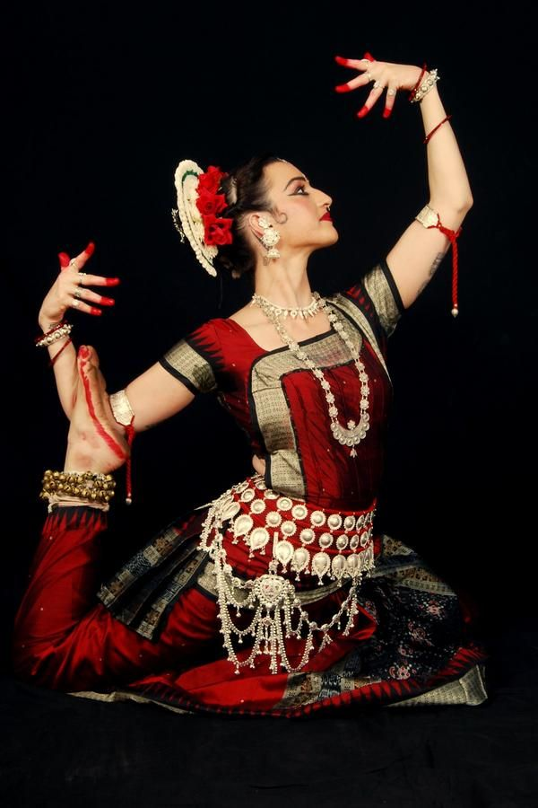 Odissi Dance clothed in traditional Indian dress (classical Indian dance)