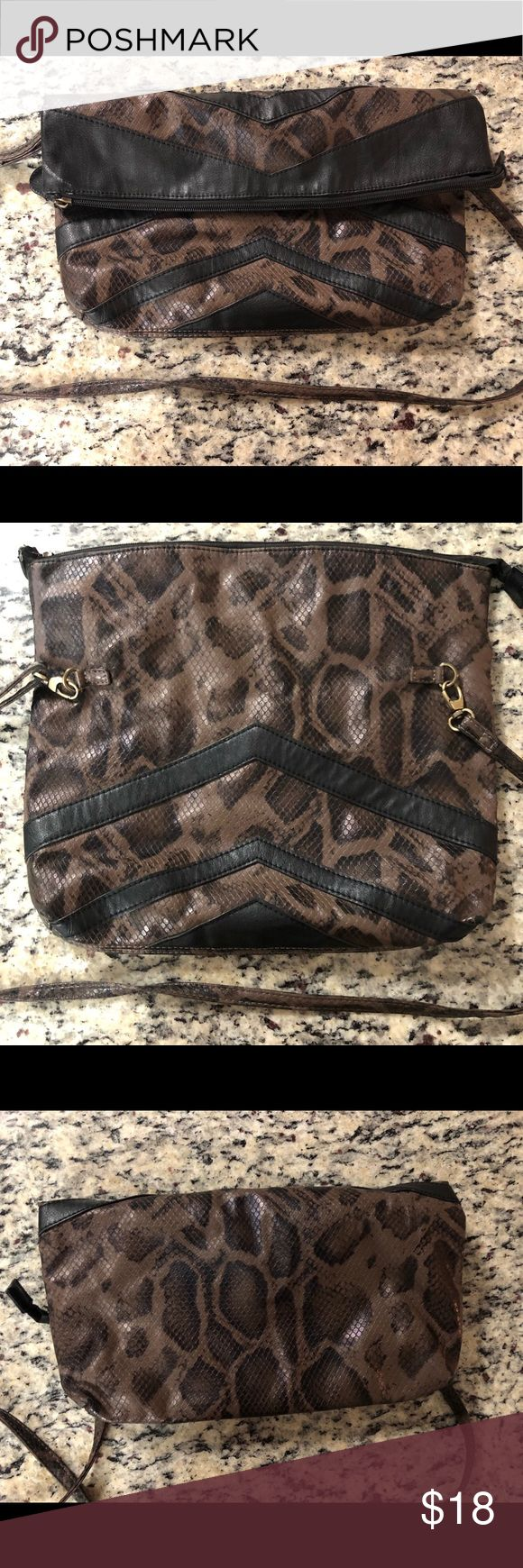 Animal print clutch Animal print clutch with removable cross-body strap! Bags Clutches & Wristlets