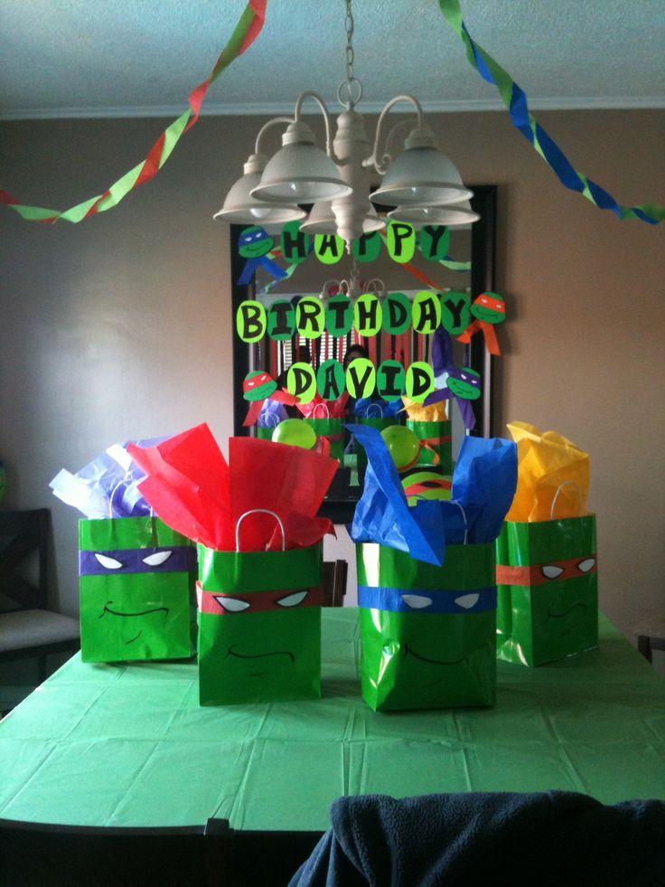 DIY ninja turtle gift bags ... Super cheap to make: green gift bags, streamer, black marker :)