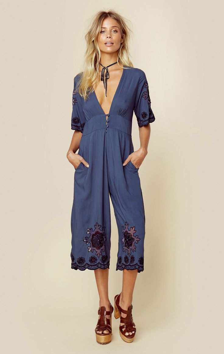 """☆This dreamy little number by Cleobella is adorned with scalloped trimmed sleeves and cropped bottoms that are delicately hand embroidered. Features a deep v neckline with accented buttons.   Made in IndonesiaDry Clean Only100% RayonFit Guide:Model is 5ft 7 inches; Bust: 32"""", Waist: 24"""", Hips: 34""""Model is wearing a size XSRelaxed FitShoes Featured Not Available For Purchase"""