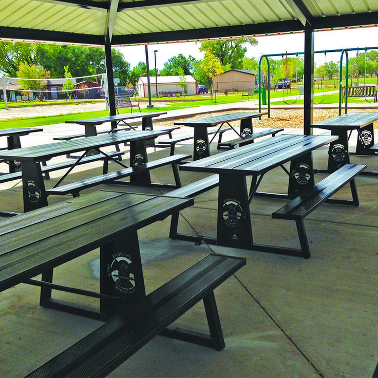 commercial picnic tables under pavilion from Premier Site Furniture