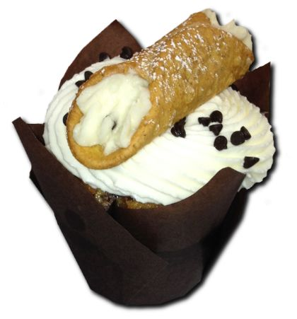 """HOLI-CANNOLI - The singular is cannolo (or in the Sicilian language cannolu), meaning """"little tube"""". Cannoli originated in Sicily and are a staple of Sicilian cuisine. And now Ethereal Cupcakes and Coffee Shoppe is making it a staple dessert in the Hampton Roads!  Incredibly moist and delicious cannoli filled Marble cake, topped off with mascarpone and a hand-filled cannoli on top."""
