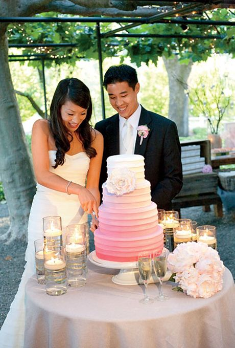 Cutting the pink ombre wedding cake. Photo: Lisa Lefkowitz