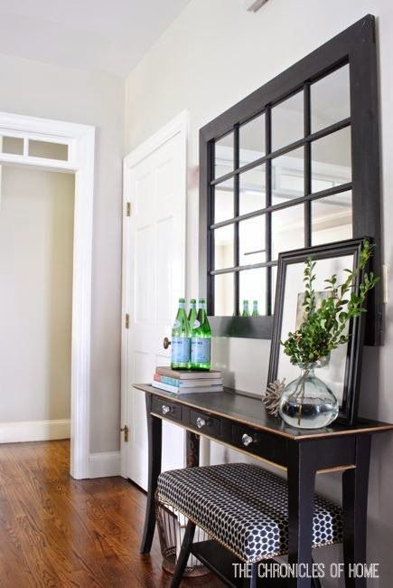 Marvelous Decorating A Bare Kitchen Wall With A Console Table And Windowpane Mirror.