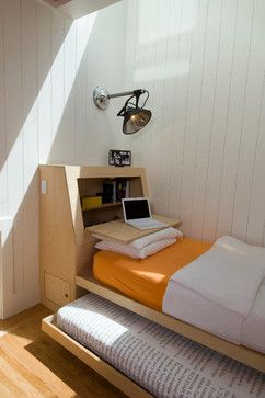 Single bed with trundle and headboard that folds into desk.  Very smart, good idea for a kid's room or dorm.