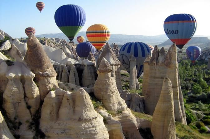 8-Day Seven Wonders of Turkey Tour This 8-day tour package offers you five most popular tourist destinations in Turkey, starting with mesmerizing Istanbul, that straddles Europe and Asia across the Bosphorus strait, adding to it classical ruins of Ephesus at beach resort town Kusadasi, world-famous hot springs and travertine terraces of carbonate minerals of Pamukkale, ancient city Ephesus and unique geological, historic, and cultural features of Cappadocia. ...