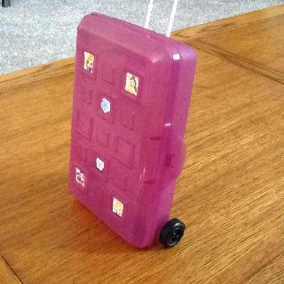 DYI American Girl suitcase made from a pencil box, the plastic part of a foam roller, stickers & 2 small wheels with axle from a hobby shop.