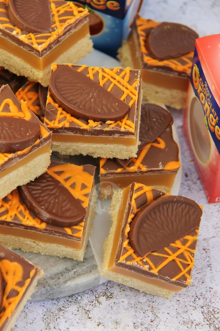 Buttery Orange flavoured Shortbread, Delicious Homemade Caramel, and Terry's Chocolate Orange Goodness on top. Perfect Christmas Traybake! So, yeah… Chocolate Orange themed Millionaires Shortbread anyone?!...