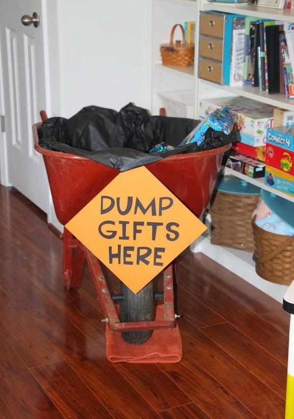 Construction Birthday Party Decoration: Add a black tablecloth for decoration and my fun dump gifts here sign to a wheel barrow and put all the gifts inside for decoration.