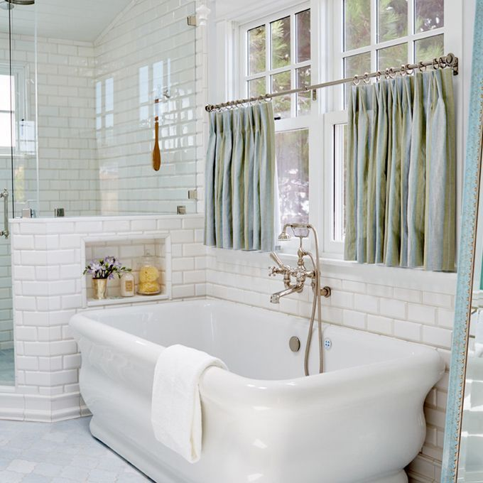 The tub, similar to Strom Plumbing's Solitude Acrylic Double Ended Pedestal Tub, is accented by turquoise curtains and gold finish. http://www.vintagetub.com/bathroom/bathtubs/freestanding-tubs/strom-plumbing-solitude-70-inch-acrylic-double-ended-pedestal-tub-with-drain-no-faucet-drillings-p0945-s.html?utm_id=IDPIN&utm_source=pinterest&utm_medium=social