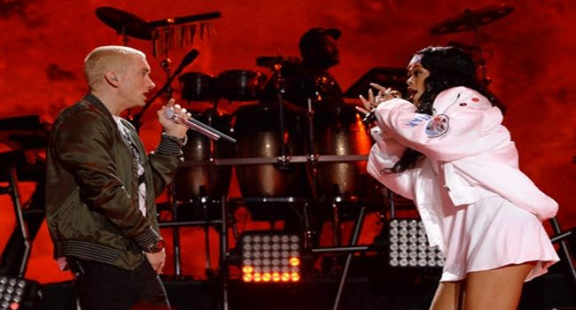 """Are Rihanna & Eminem Fooling Around? [Rumors]- http://getmybuzzup.com/wp-content/uploads/2014/08/rihanna1.jpg- http://getmybuzzup.com/rihanna-eminem-fooling-around/- Rihanna & Eminem Are HEATING UP?! Rihanna and Eminem are mixing business with pleasure and the frequent collaborators may soon be singing """"We Found Love.""""Enjoy this videostream below after the jump. They first hooked up professionally in 2010 for """"Love the Way You Lie."""" Following three more...- #E"""
