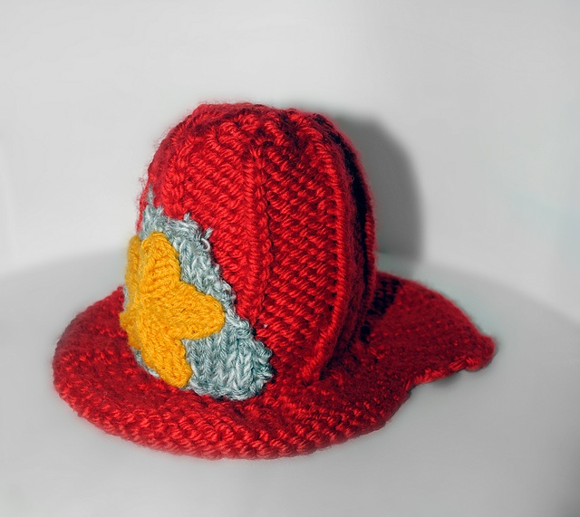Ravelry: Feisty Fireman Hat pattern by Christy Harris - too darn cute!  I never think to design this type of thing but it is adorable.