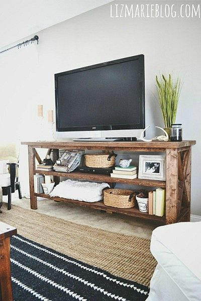 chair placement. rugs on top of carpet (LOVE THIS IDEA) and rustic entertainment center