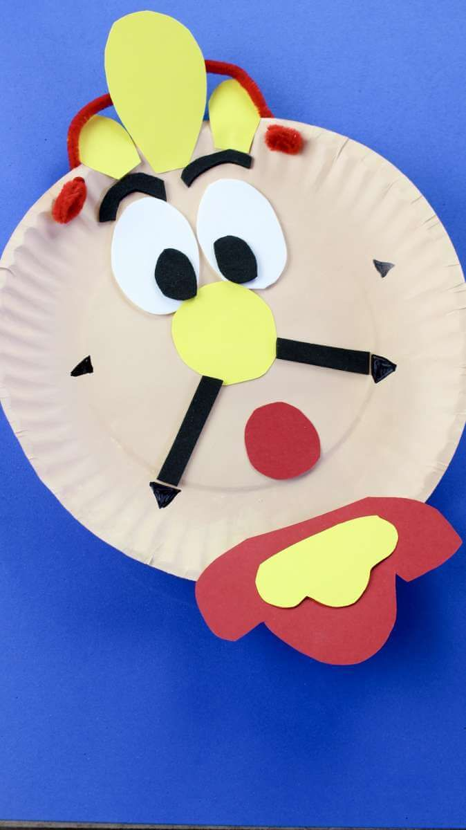 how to make a Beauty And The Beast Cogsworth Clock Craft. This is a fantastic and easy craft to make with children using a paper plate. Cogsworth is a