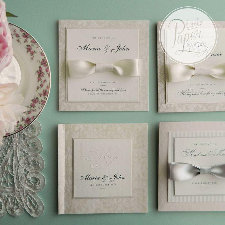 a range of invited with layers of textured and patterned paper and embossed initial detail.
