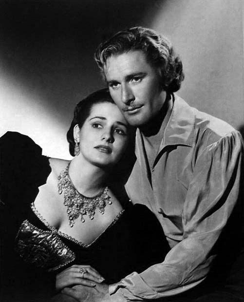 Brenda Marshall and Errol Flynn, The Sea Hawk (1940).