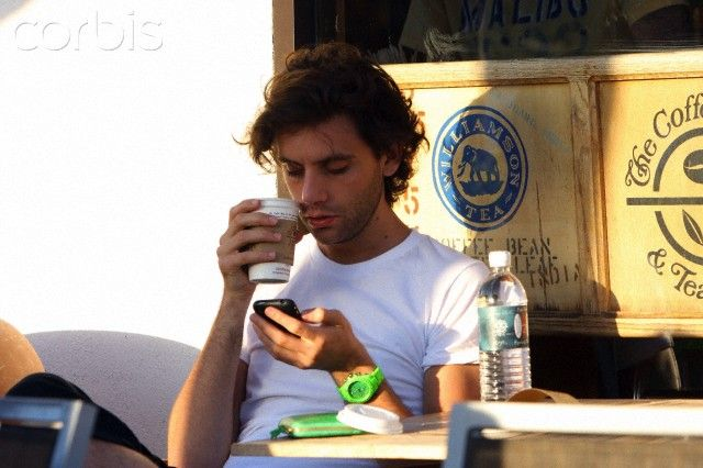 """British singer Mika enjoys a tea with a female friend in Cross Creek, Malibu. Mika seems to like the colour green with matching watch and wallet/purse"" Apr 5 2009"