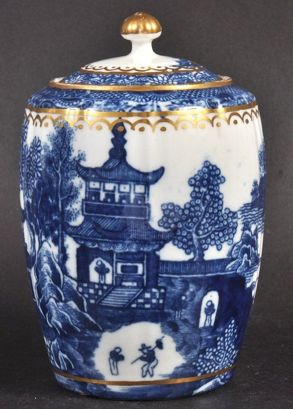 18th century Caughley tea caddy decorated in blue and white chinoiserie Temple pattern (pagoda scene) transfer-printed in underglaze blue on white, with gilded highlights, c. 1700s, porcelain, Caughley Porcelain Factory, UK