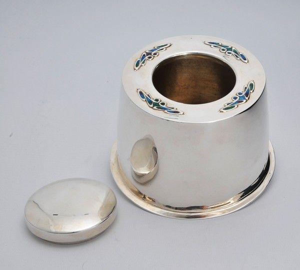 A Cymric silver art nouveau modernist silver and enamel tea caddy