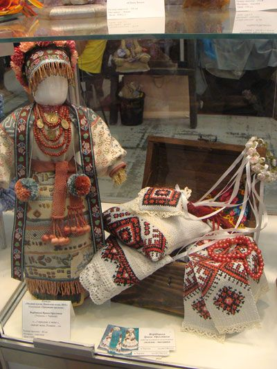 A traditional Ukrainian doll called MOTANKA. They draw no faces (no eyes, nose, mouth) to let small children develope their imagination and think of the doll`s emotions while playing with the doll. A sample from the Doll Salon (craft show) held in Kiev, Ukraine.
