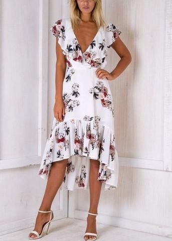 35c3461d36 Vestido midi confeccionado em poliéster com estampa floral. De comprimento  mullet