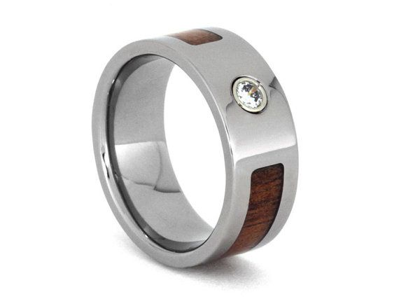 *14k white gold bezel only available with titanium ring, setting will be flush if you would like the entire ring to be made in precious metal. This wood ring comes with FREE ring armor waterproofing (a $75 value). RING LAYOUT Ring Width: 8 mm Ring Sleeve: Titanium Ring Profile: Flat