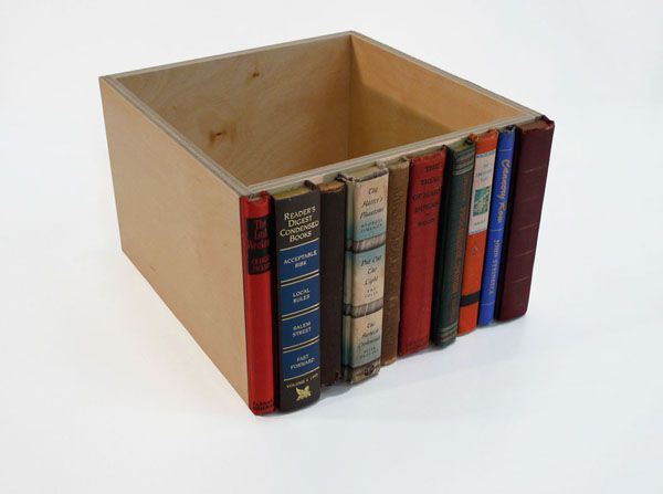 Hide clutter in boxes that look like antique books - good for the mail center