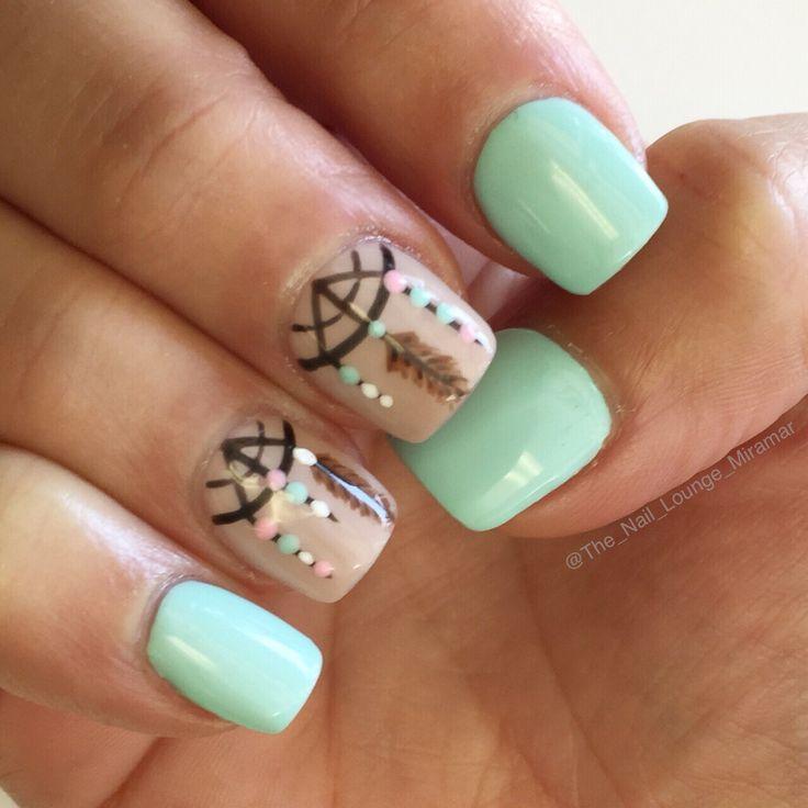 Mint green dreamcatcher nail art design