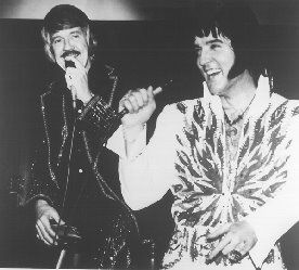 JD Sumner on stage with Elvis Presley - In 1971, the Stamps were hired by Elvis Presley to tour and record.  They backed Presley on each of his albums throughout the '70s and appeared onstage during his televised concerts of the era.  Sumner broke up the Stamps in 1980 but formed a new version by the end of the decade.  J.D. Sumner, 73, passed away while on tour with the Stamps on November 16, 1998.
