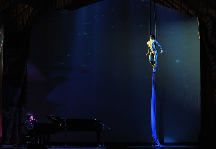 "Nico Gattullo performs aerial silks act on ""Hallelujah"" sung and played on piano by Rufus Wainwright during Cavalchina at Teatro La Fenice in Venice. Photo: Romina Greggio"