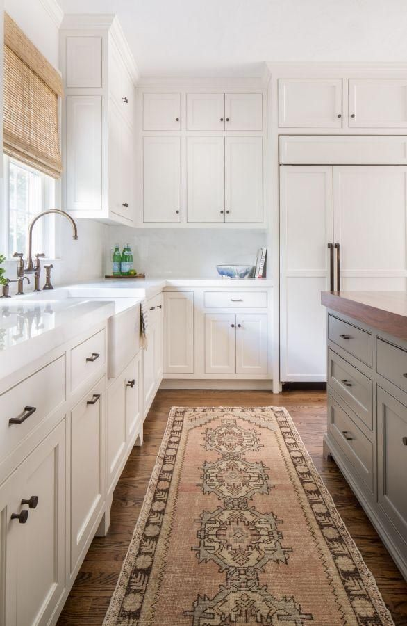 Neutral kitchen with butcher block counter kitchen island, neutral beige and gray Turkish runner rug, all-white kitchen cabinets and granite composite counter tops. Interior design and styling by Jamie Keskin Design.