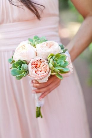 Posy: These petite, compact arrangements can be held in one hand. The stems are typically wrapped in ribbon fastened with pearl pins to. Their smaller size makes them a popular choice for bridesmaids and a perfect option for brides who really want to show off their gowns! {Mi Belle Photographers}