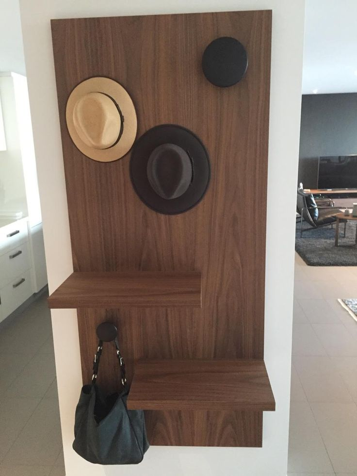 Custom Wall Hung Coat & Bag Rack. This American black walnut veneer was designed by Sally Timms for a private client. It can be custom made to suit your needs and requirements.