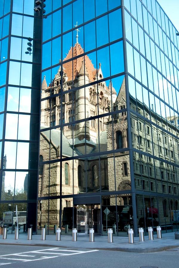 Trinity Church reflected in the John Hancock Tower in Boston, MA