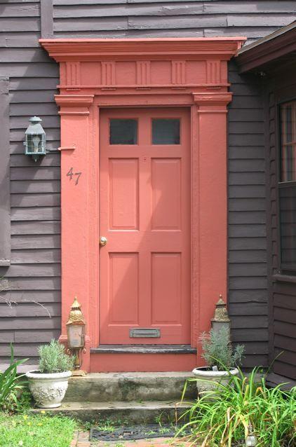 Coral front door. Decorative trim of columns and transom in coral, too. front door. coral door.
