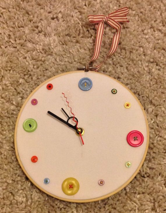 A button clock available in a range of colours, fabrics and designs. Each clock is made to order and customised to the customers needs. Numbers