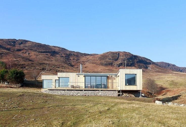 Boutique Modern rose to the challenge of building a modular prefab in a remote location in Ullepool in the Scottish Highlands. Because of the area's extreme weather conditions, the builders used thicker wall sections with added external insulation to ensure the house stays warm in winter. Photo 7 of 8 in 7 Modern Modular and Prefabricated Homes in the UK