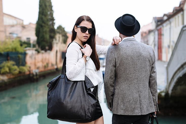 Le Parisien travel tote in black leather. Shot in Venice by Cassandra Ladru wandererstravelco.com