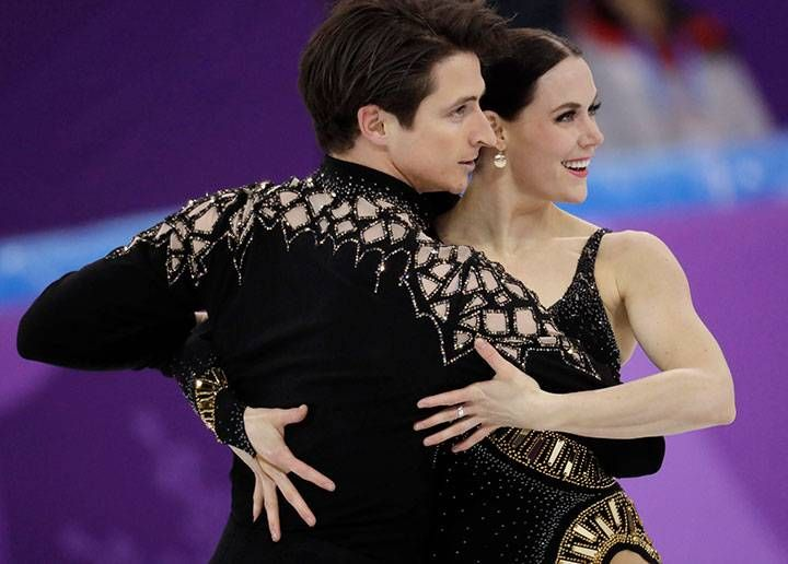 Canada's Tessa Virtue and Scott Moir perform during the ice dance short dance team event in the Gangneung Ice Arena at the 2018 Winter Olympics in Gangneung, South Korea, Feb. 11, 2018.