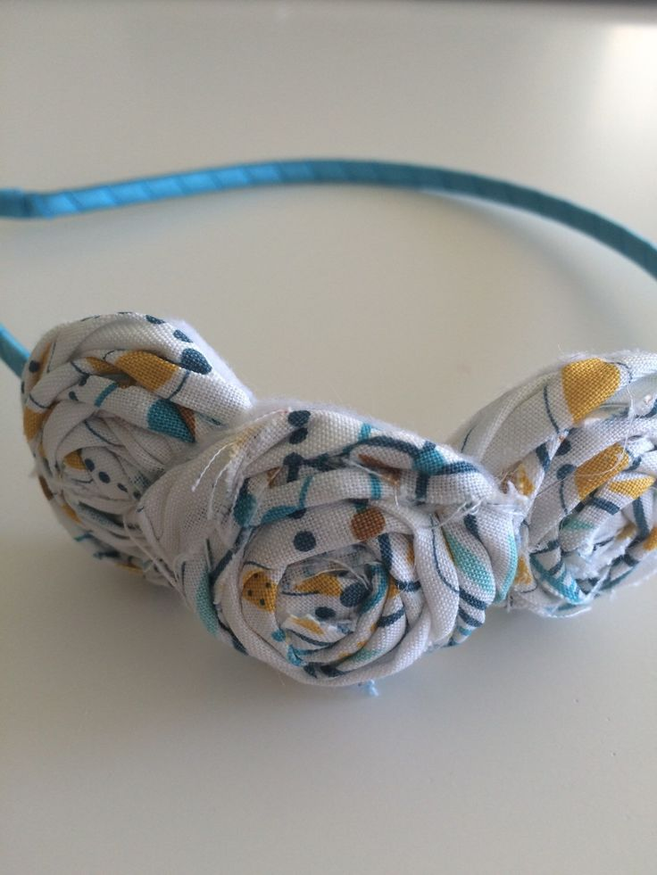 A personal favorite from my Etsy shop https://www.etsy.com/listing/247221329/fabric-rossette-metal-headband