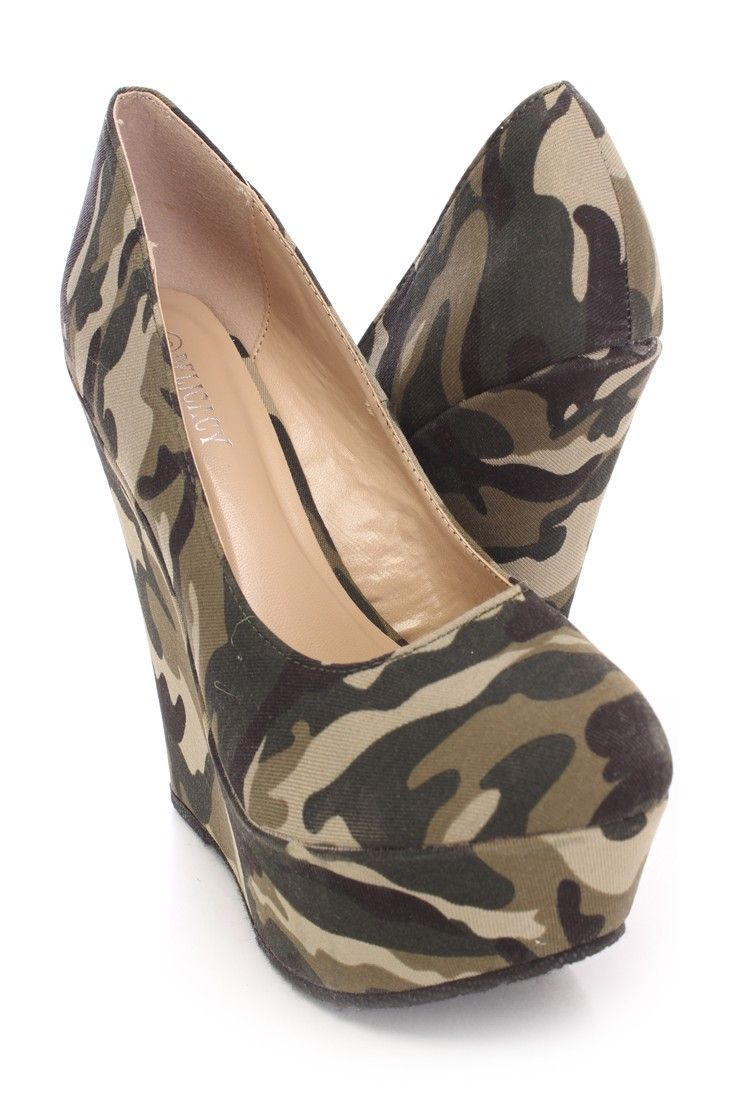 You will be head over heels for these saucy little numbers! They will perfectly compliment any outfit for any occasion! Make sure to add these to your collection, they definitely are a must have! The features include a canvas fabric upper with a camouflage print throughout, round closed toe, scoop vamp, smooth lining, and cushioned footbed. Approximately 5 inch wedge heels and 2 inch platforms.