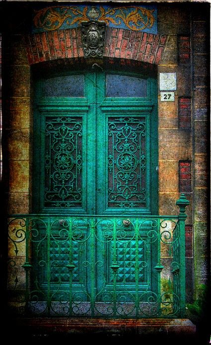 I happen to love everything about this!  The color of the door, the wrought iron rail, the pastel colors in the brick! #awesome #teal #door