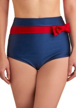 goes with the red halter, i like that the colors/theme is nautical without being in your face sailor kitchy