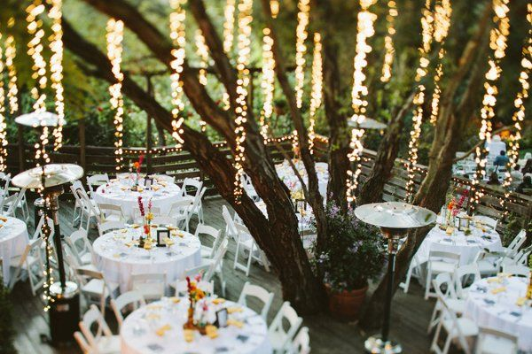 Hanging string lights cascade from a tree at this patio reception adding some elegance to the casual ambiance! {Laura Izumikawa Photography}