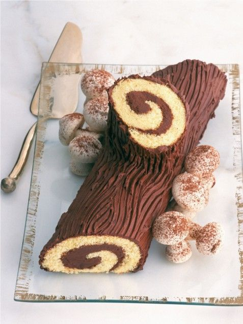 The traditional dessert of La Reveillon ( the French Christmas meal traditionally served after midnight mass)  is a buche de noel (yule log), a rolled sponge cake filled with flavored buttercream and decorated to look like a fallen log, finished with powdered sugar (for snow) and meringue mushrooms.