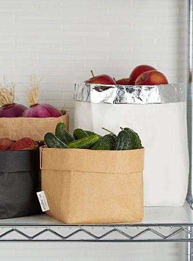 Essent'ial collection from Italy at Simons Maison   Eco-design accessory to decorate the table in a chic, rustic style   Pretty paper bag effect in washable cellulose fibre   14 x 14 x 23 cm
