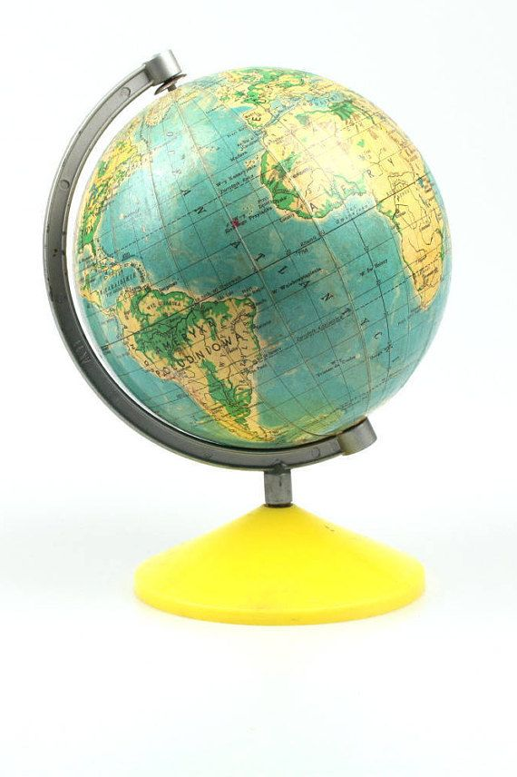 Vintage 7 inch world globe from 1986. Its in good condition. Has yellow plastic round base and Polish text. This earth globe does show wear consistent with age and use. It will be great office accessory for your office or home decor in vintage style collectibles. It has very nice