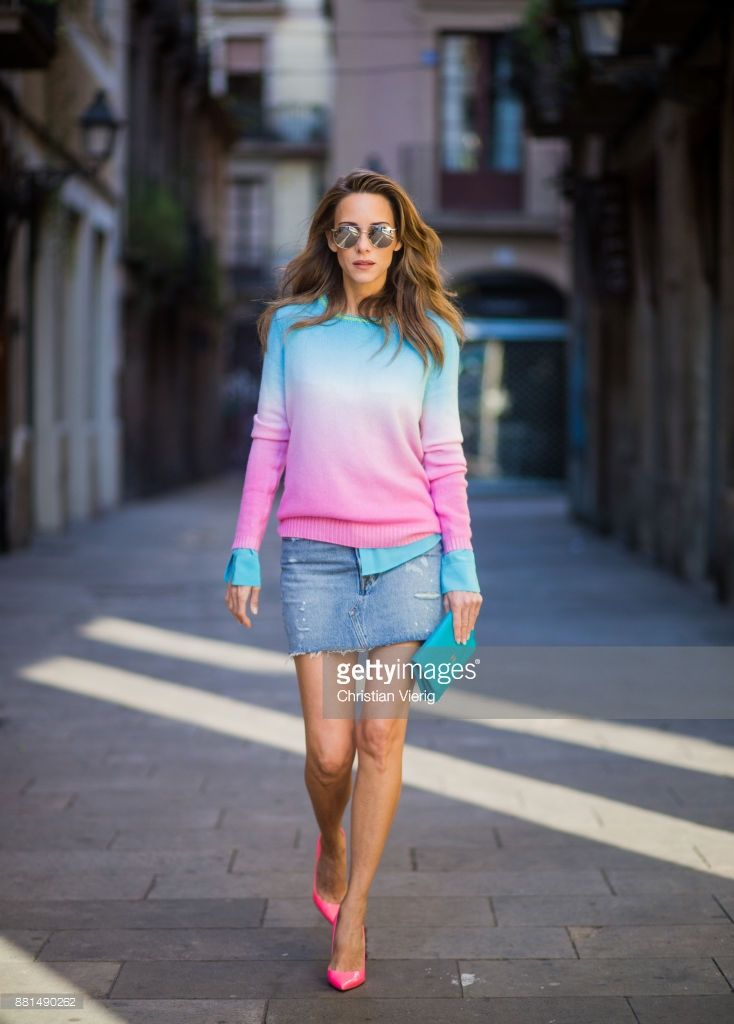 Alexandra Lapp wearing mini jeans skirt from Levis, batik cashmere pullover from Heartbreaker in turquoise and pink, Jadicted silk blouse in turquoise, little purse bag from Chanel with golden Chanel sign, silver mirrored sunglasses from Le Specs and pink patent So Kate heels from Christian Louboutin on November 28, 2017 in Barcelona, Spain.