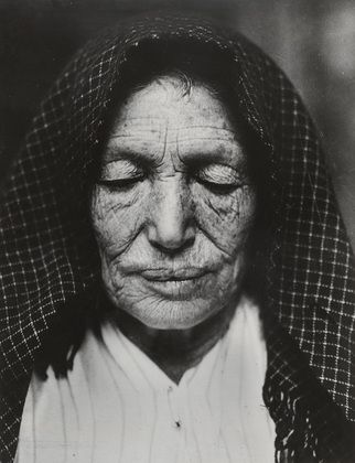 An amazing photo of an old Italian woman at Hull House, c.1910, Chicago.    By Lewis Hines.